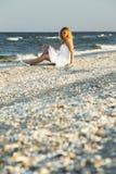 Woman on white sand beach Royalty Free Stock Photo