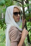 Woman in a white scarf Stock Photos