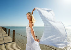Woman with white shawl Royalty Free Stock Photography