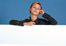 Woman with white shield. Business woman with a white shield stock photo