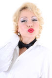 Woman in white shirt and black bow-tie kissing Royalty Free Stock Photo