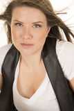 Woman white shirt black vest close hair blow serious Stock Images
