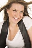 Woman white shirt black vest close hair blow smile Royalty Free Stock Images