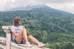 Woman in White Shirt and Blue Denim Short Shorts Sitting Royalty Free Stock Photos