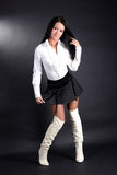 Woman in white shirt and boots Royalty Free Stock Images