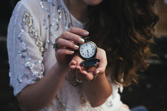 Woman in White Shirt Holding White Pocket Watch Stock Image