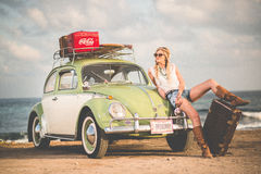 Woman in White Shirt Near in Green Beetle Car Stock Photos