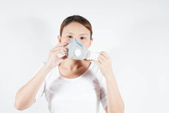 Woman in white shirt with pollution mask Royalty Free Stock Image