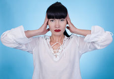 A woman in a white shirt posing with her hands on her head Royalty Free Stock Images