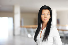 Woman in white shirt standing Stock Image
