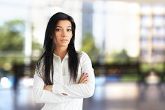 Woman in white shirt standing with crossed arms Royalty Free Stock Photography