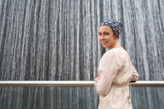 Woman in white shirt standing near big fountain Stock Photography
