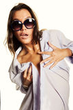 Woman in white shirt and sunglasses. Wet woman in white shirt and sunglasses Stock Image