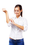Woman in white shirt turning up sleeves. Lovely woman in white shirt turning up sleeves Royalty Free Stock Image