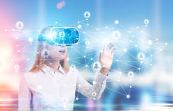 Woman in white shirt in vr glasses royalty free stock images