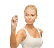 Woman in white shirt writing in the air Stock Photography