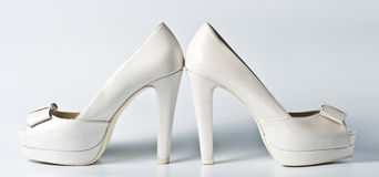 Woman white shoes on white. Background Royalty Free Stock Image