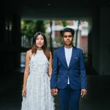 Woman in White Sleeveless Dress and Man on Blue Blazer Royalty Free Stock Image