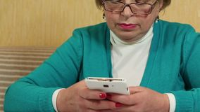 Woman with white smartphone. Woman typing sms on her cell phone stock video