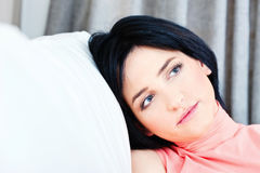 Woman on white sofa at home Stock Photos