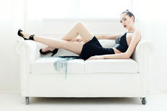 Woman on a white sofa Royalty Free Stock Photography