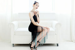 Woman on a white sofa Royalty Free Stock Image