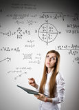 Woman in white is solving equation Stock Photography