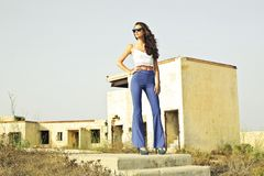 Woman in White Spaghetti Strap Crop Top and Blue Pants Stock Images