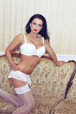 Woman in white stockings Royalty Free Stock Image
