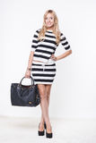 Woman in white striped top and skirt Royalty Free Stock Image