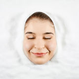 Woman and white sugar Stock Image