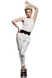 Woman in white suit Royalty Free Stock Photo