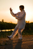 Woman in white suit make's taiji chuan - 10. Woman in white suit make's taiji chuan exercise - chinese marshal art Stock Images