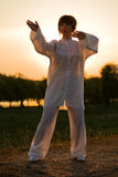 Woman in white suit make's taiji chuan - 6 Royalty Free Stock Photo