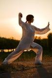 Woman in white suit make's taiji chuan - 7