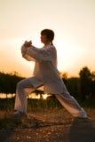 Woman in white suit make's taiji chuan - 8