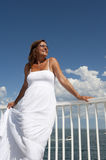 Woman in White Summer Dress on Lookout Stock Photography