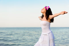The woman in a white sundress on seacoast Royalty Free Stock Photography