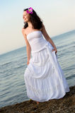 The woman in a white sundress on seacoast. Stock Image