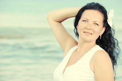 The woman in a white sundress on seacoast. Royalty Free Stock Images