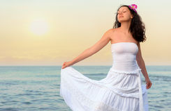 The woman in a white sundress on seacoast Royalty Free Stock Images