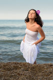 The woman in a white sundress on seacoast. Royalty Free Stock Photos