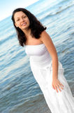 The woman in a white sundress on seacoast. Royalty Free Stock Photo