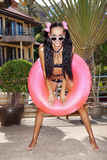 Woman in white sunglasses with pink inner tube royalty free stock photo