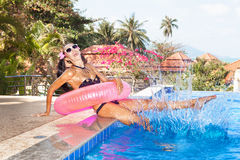 Woman in white sunglasses with red inner tube Royalty Free Stock Photography
