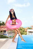 Woman in white sunglasses with red inner tube Stock Photography