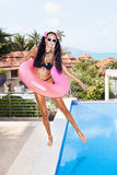 Woman in white sunglasses with red inner tube Stock Photo