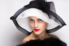 Woman white sunhat. Closeup portrait of beautiful girl woman lady with professional make up big sunhat. Luxury accessory New Bright color makeup, shiny lipstick Royalty Free Stock Image