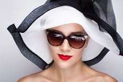 Woman white sunhat. Closeup portrait of beautiful girl woman lady with professional make up big sunhat. Luxury accessory New Bright color makeup, shiny lipstick Stock Images