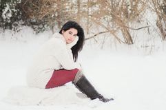 Woman In White Sweater Sitting Near Grass During Winter Season Stock Images